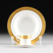 A THIRTY SIX PIECE ROYAL CROWN DERBY PARCEL GILT WHITE GROUND DEMITASSE AND SOUP BOWL SET, ST. GEORGE PATTERN, OVERGLAZE RED AND IMPRESSED MARKS, 1931,
