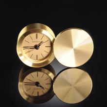 A TIFFANY & CO. GOLD TONED CIRCULAR TRAVELING CLOCK, SIGNED, THIRD QUARTER 20TH CENTURY,