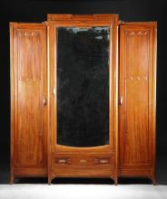 AN ART DECO PARQUETRY INLAID CARVED MAHOGANY ARMOIRE, POSSIBLY GERMAN, CIRCA 1919,