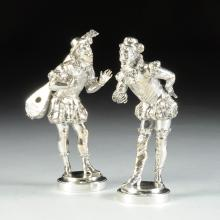A PAIR OF CONTINENTAL SILVER PLATED BRONZE MINSTREL FIGURES, SIGNED