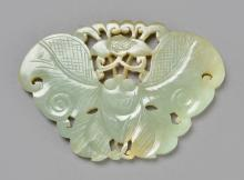 PALE GREEN JADEITE PENDANT CARVED IN THE FORM OF A