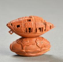 OLIVE-STONE MODEL OF A BOAT AND STAND