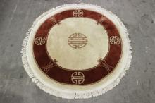 A round Chinese hand made rug