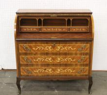 A fine European roll top desk with inlaid