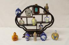 13 snuff bottles, and a snuff bottle stand