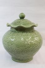 A large Chinese celadon glazed covered jar