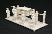 Antique ivory carved royal procession