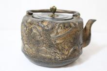 A fine cast iron teapot