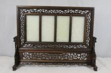4 white jade plaques on rosewood stand