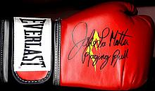 BOXING: Three red Everlast boxing gloves of