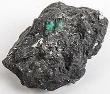 An Uncleaned Rock with Two Embedded Emeralds from St. Augustine, Florida