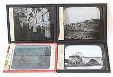 Lot of four early 20th century glass slides for a magic lantern