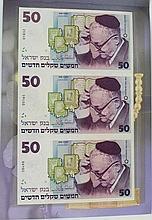 Three uncut 50 shekels (NIS) banknotes