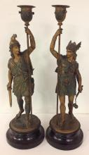 PAIR OF WHITE SPELTER WARRIORS CANDLESTICKS, MEASURE 19