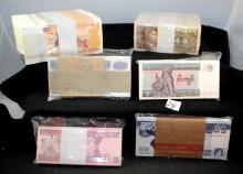 6 BUNDLES OF UNWRAPPED FOREIGN CURRENCY