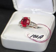 LADIES 14K WHITE GOLD RING CONTAINING 8 PRINCESS CUT CUT DIAMONDS AND 1 OVAL RUBY MEASURING 10.5X9MM. THE REPLACEMENT COST IS $3,000.00. AND COMES WITH THE APPRAISAL FOR INSURANCE PURPOSES