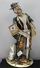 Capodimonte style 'Hunter with dog' figu