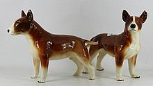 A pair of porcelain Stafforshire Bull Te