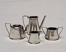 A Hallmarked silver dolls tea set (4 pie