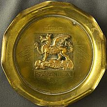 WWI Military Trench Art: brass ashtray with a fluted rim and the regiments insignia at its center, a dragon and