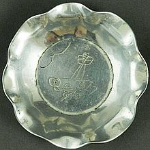 WWI Military Art: An ashtray made from duralumin, probably from the wreckage of Zeppelin LZ85, which was brought down over Salonica in May 1916. It has a fluted rim and a rough engraving depicting an airplane under the clouds. In very good condition