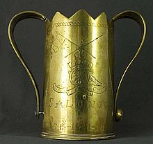 WWI Military Trench Art: a two-handled trophy-like jar with scalloped top edge fashioned from brass shell casing, decorated with engravings with the insignia of the Royal Horse Artillery, with the British and French flags & further engraved