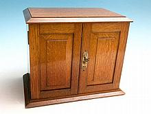 An old oak stationery cabinet with fitted