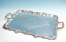 A large rectangular silver plated serving tray