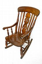 A Victorian railed back rocking chair.