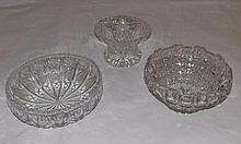 Cut glass vase and 2 circular glass fruit bowls.