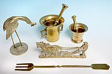 Two brass pestles, mortars and other brass.