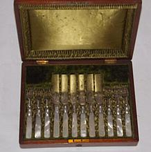 Cased set of 6 silver plate fruit knives and forks