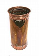 An old copper and brass cylindrical stick stand.