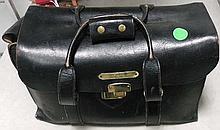 2 Leather brief cases .