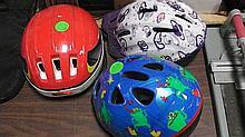3 Bicycle helmets .