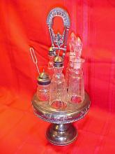 Early Victorian silver and crystal cruet set