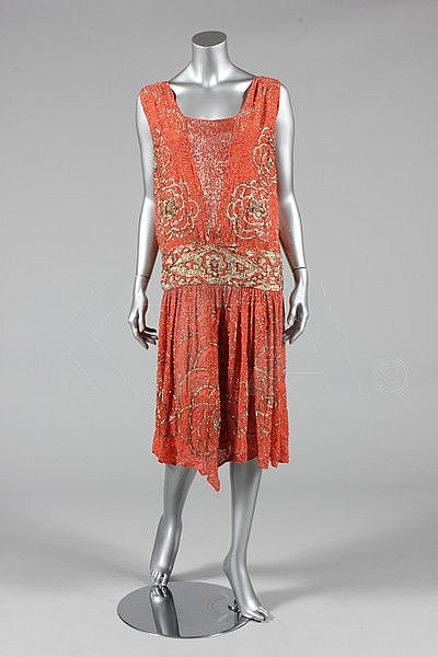 A beaded coral crepe flapper dress, circa 1928,