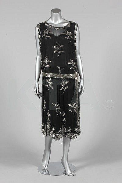 A silver beaded black chiffon cocktail dress,