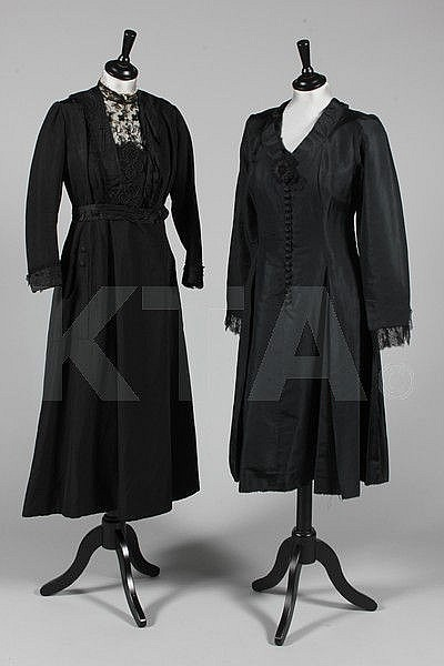 A group of mainly black clothing dating from 1900,