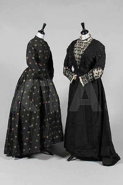A black and gold figured silk gown, circa 1865,