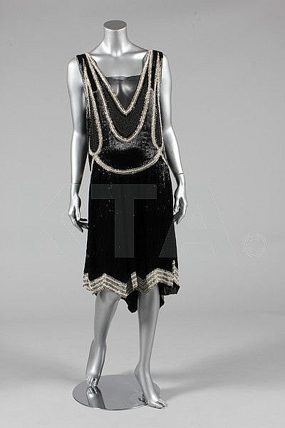 A black beaded flapper dress, circa 1928, the