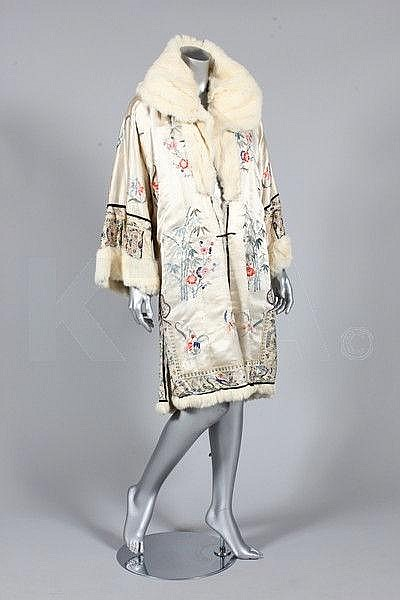 An embroidered ivory satin evening coat, Chinese