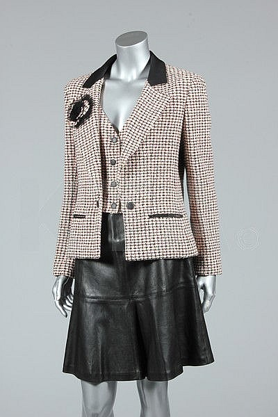A Chanel boutique pink and black tweed jacket with
