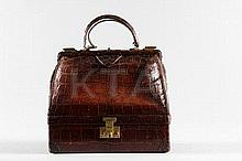 An Hermès brown crocodile malette, probably 1930s,