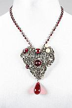 An Yves Saint Laurent heart-pendant