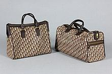 A group of Christian Dior luggage and accessories,