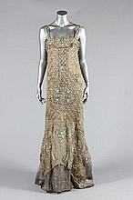 An opulent be-jewelled orientalist cloth of silver