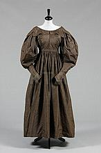 A brown taffeta dress, circa 1835, with gigot