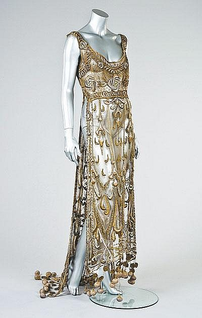 An embroidered gold tulle tabard, circa 1910-12,