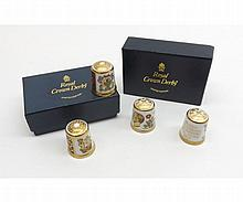 Two boxed sets of Royal Crown Derby Commemorative Thimbles, two commemorating the 1986 Royal Wedding and to commemorate Queen Victoria's Accession and Prince Albert, all modern